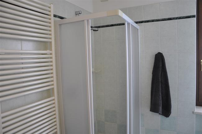 bathroom with shower and washing machine