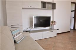 Living room with sofa and SAT-TV